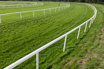 Horse race track corner barrier fence
