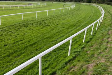 Horse race track corner barrier fence