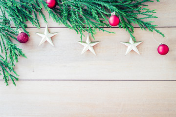 christmas tree with christmas decoration on wood background