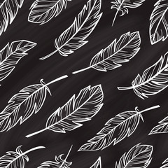 Vector feathers seamless pattern on a chalkboard backgroundon a chalkboard background