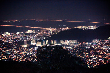 Amazing Cityscape Penang downtown at night, from the top of view on skyscraper, show lighting on the road of communication concept.