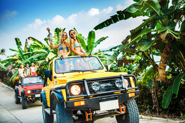 Friends Enjoying Vacation In Offroad Vehicles on Koh Samui, Thailand