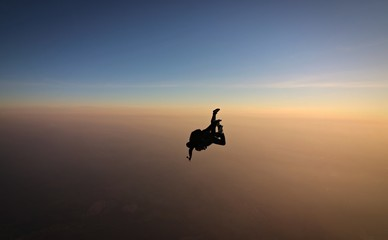 Skydiving tandem sunset with soft focus on the background