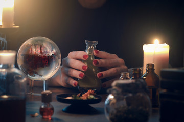 Witchcraft. The hands of witches, magic ball