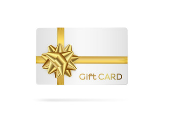 Gift white card with golden ribbon.