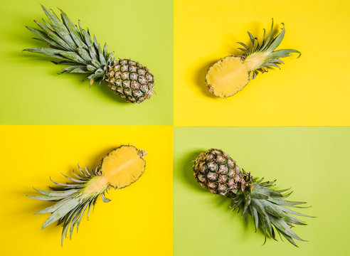 Four pineapples on yellow and green background