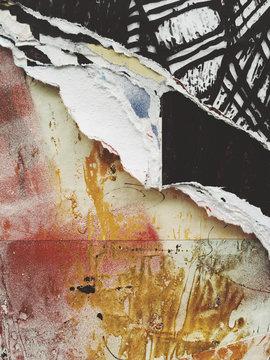 Peeling poster art and graffiti, close up