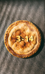Pi: Dark Pie With Shadows Across On Black Background