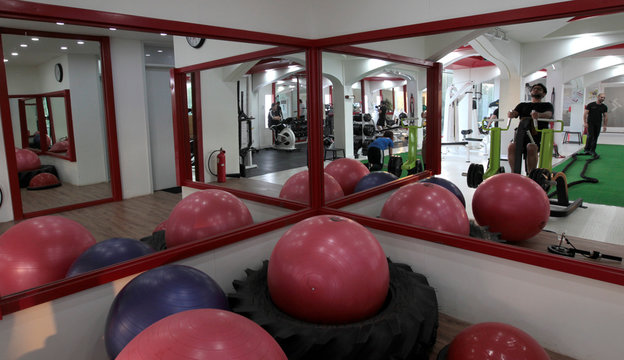 Men and women do cross fit training at a gym in Islamabad
