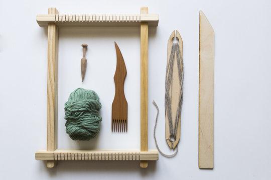 Weaving loom, tools and yarn