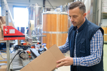 portrait of adult glad male brewery worker
