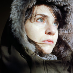 Closeup of a woman in a warm parka jacket