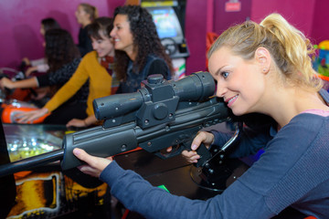female shooting with gun video game