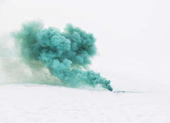 green smoke on the white snow