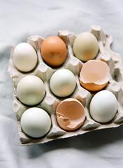 Nine eggs in carton on table