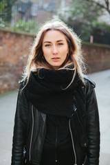 Beautiful woman in winter clothing in an urban area