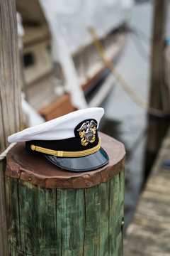 Military naval officer's lid on pier piling - vertical
