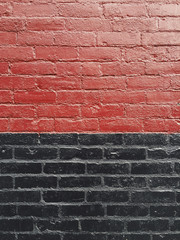 Painted red and black brick wall