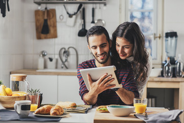 Couple Looking Something on a Tablet