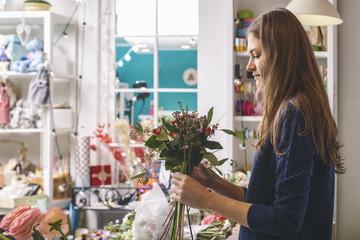 Side view of florist arranging bouquet