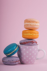 Delicious colorful macaroons on a pink background