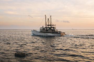 Fishing boat heading to sea