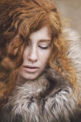 Portrait of a redhead in a fur coat