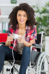 young disabled woman playing video games at home