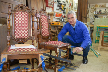senior man restoring a chair