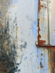 Detail of rusty metal trash can with scratch marks