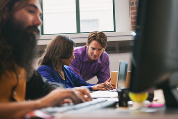 Office: Man And Woman Working Together On Project
