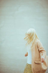 Woman twirls in a circle