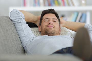 man lying on the sofa Wall mural