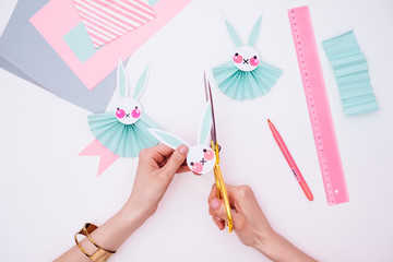 Woman Making Easter Bunny Rosettes As an Easter Decoration