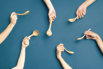 Spoon and hands composition