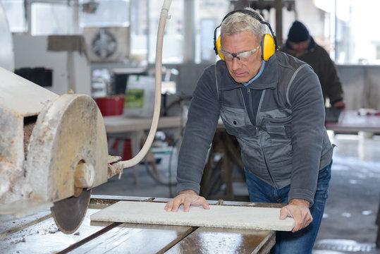 Man using industrial circular saw