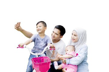 Muslim family takes a picture together on studio