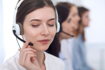 Call center operator.Young beautiful business woman in headset Fototapete