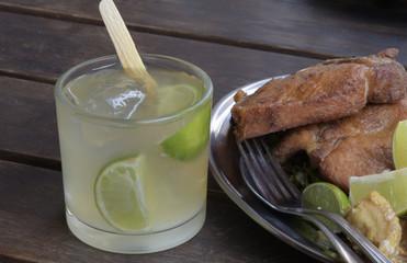Caipirinha, the famous Brazilian drink, on wooden table
