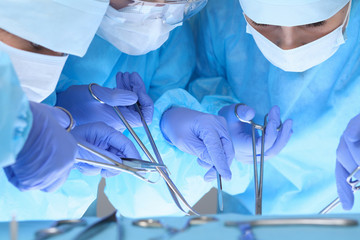 Close-up of medical team performing operation. Group of surgeons at work are busy of patient. Medicine, veterinary or healthcare and emergency in hospital