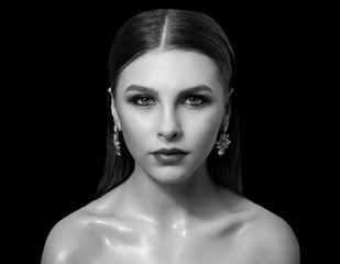 Fashionable portrait of a girl model. Fashion, accessories, evening  wet effect makeup.