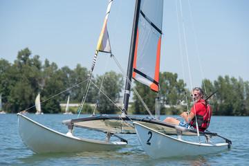 man sailing on lake
