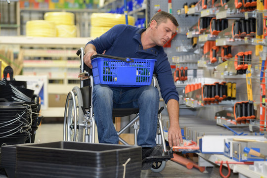 disabled man in a hardware store