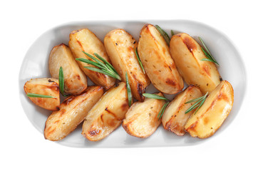 Delicious baked potatoes with rosemary on plate, isolated on white