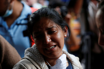 A relative reacts after the body Maria Ortiz was recovered from a collapsed building after an earthquake hit Condesa neighbourhood in Mexico City