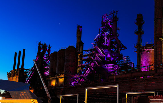 Steel stacks with purple and yellow lighting as entertainment area in downtown Bethlehem Pa.