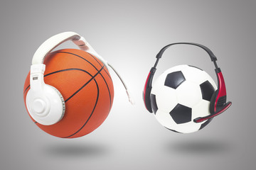 Basketball with football and headphones on a white backdrop.