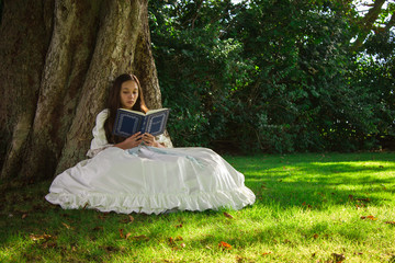 Girl reading in woods 2