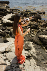 girl in orange dress with violin