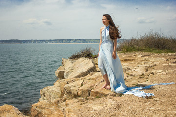 Girl in blue dress on a cliff 7